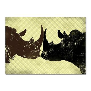 two bull rhinos fighting by indira albert
