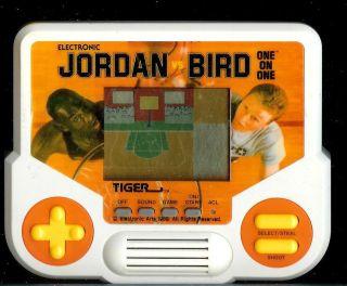 1990s Michael Jordan vs Larry Bird Tiger Electronic Handheld Basketball Game