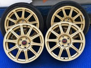 07 Subaru STI Gold BBs Factory Wheels Tires