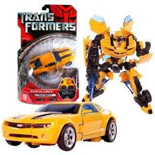 Hasbro Year 2007 Transformers Movie Deluxe Class 6 Inch Tall Robot Action Figure   Autobot BUMBLEBEE with Cannon that Converts to Blade (Vehicle Mode: Camaro Concept): Toys & Games